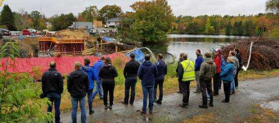 Halifax Water employees and Water Research Foundation employees looking at lake